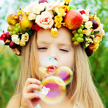 Photo of girl blowing bubbles